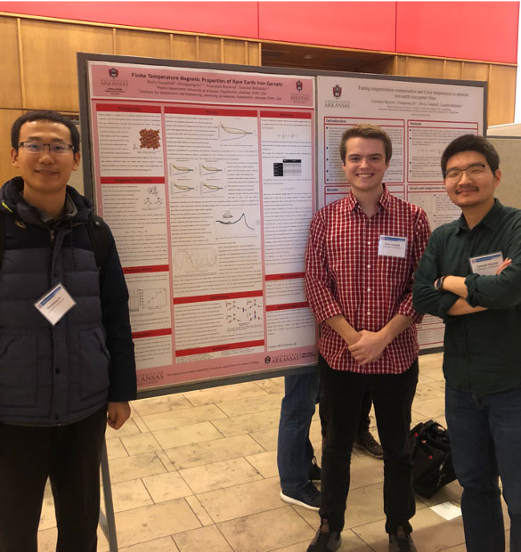 Conference Photo of  Davis and Campbell presenting a poster on Physics